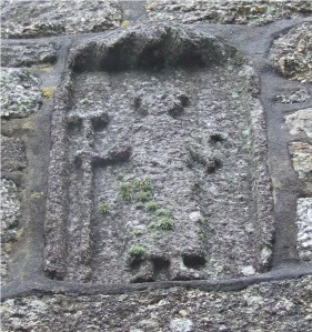 Above the porch of Ludgvan church is a figure that appears to be holding the tools of a miner. We could find no corroboration, however.