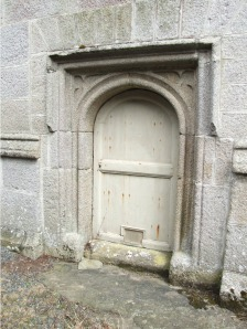 In the west door of Runan Minor church there's an arrangement similar to that at Mullion - a cat flap. We could not discover why this is here.