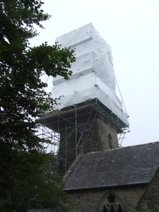 St Hilary Spire (one of the few as most churches in thie area have towers) undergoing renovation. the church itself is curions, being an old church undergoing quite radical modernisation. Some of it seems really out of place to our eyes.